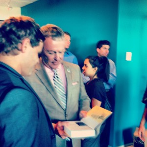 Evan Klassen meets Mayor Of City of Orlando Buddy Dyer signing his best selling book think and grow rich today_ Entreprneur